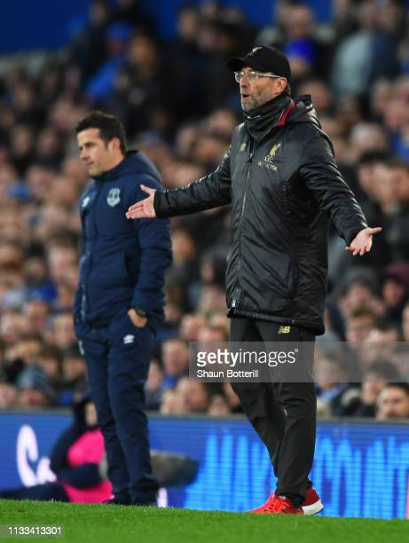 Jurgen Klopp Manager of Liverpool reacts as Marco Silva Manager of Everton looks on during the Premier League match between Everton FC and Liverpool...