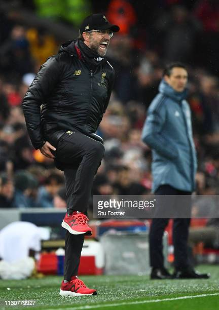 Jurgen Klopp Manager of Liverpool reacts as Niko Kovac Manager of Bayern Munich looks on during the UEFA Champions League Round of 16 First Leg match...