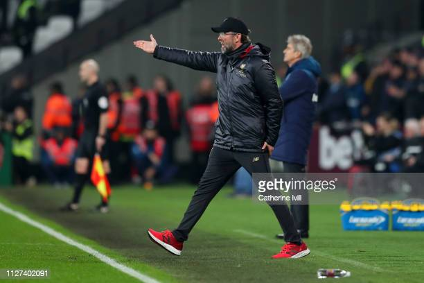 Jurgen Klopp Manager of Liverpool reacts during the Premier League match between West Ham United and Liverpool FC at London Stadium on February 04...