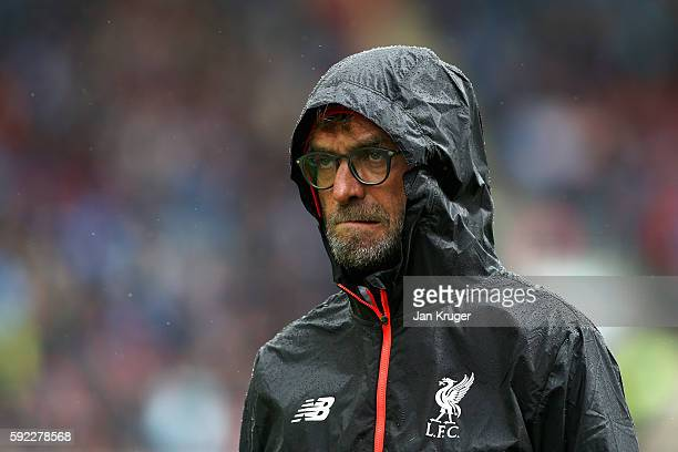 Jurgen Klopp Manager of Liverpool reacts to the rain during the Premier League match between Burnley and Liverpool at Turf Moor on August 20 2016 in...