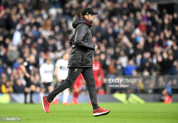 Jurgen Klopp Manager of Liverpool runs off the pitch at half time during the Premier League match between Fulham FC and Liverpool FC at Craven...