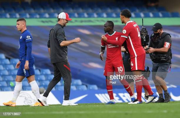 Jurgen Klopp Manager of Liverpool Sadio Mane and Virgil van Dijk of Liverpool celebrate after the Premier League match between Chelsea and Liverpool...