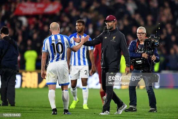 Jurgen Klopp Manager of Liverpool shakes hands with Aaron Mooy of Huddersfield Town at the final whistle during the Premier League match between...