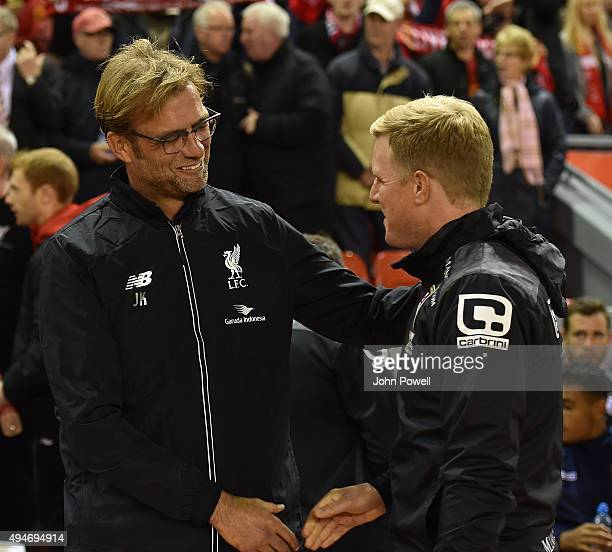 Jurgen Klopp manager of Liverpool shakes hands with Eddie Howe manager of AFC Bournemouth before the Capital One Cup Fourth Round match between...
