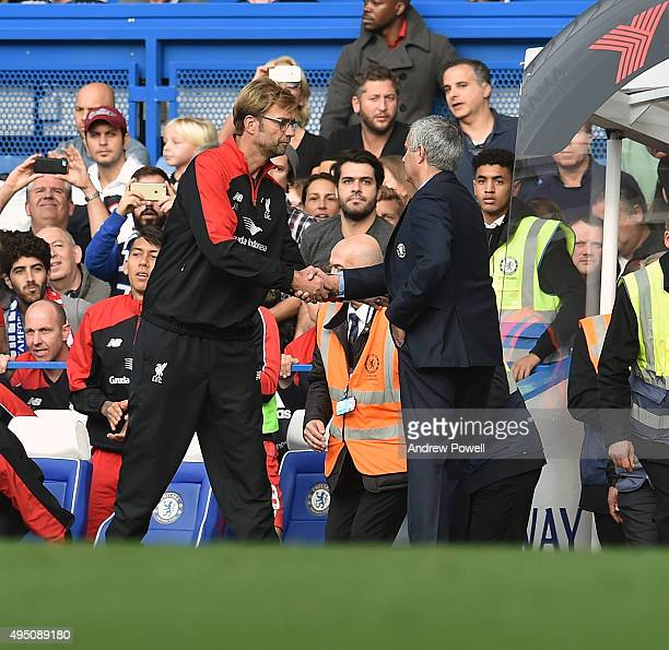 Jurgen Klopp manager of Liverpool shakes hands with Jose Mourinho manager of Chelsea at the end of the Barclays Premier League match between Chelsea...