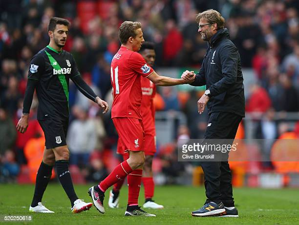Jurgen Klopp manager of Liverpool shakes hands with Lucas Leiva of Liverpool after the Barclays Premier League match between Liverpool and Stoke City...