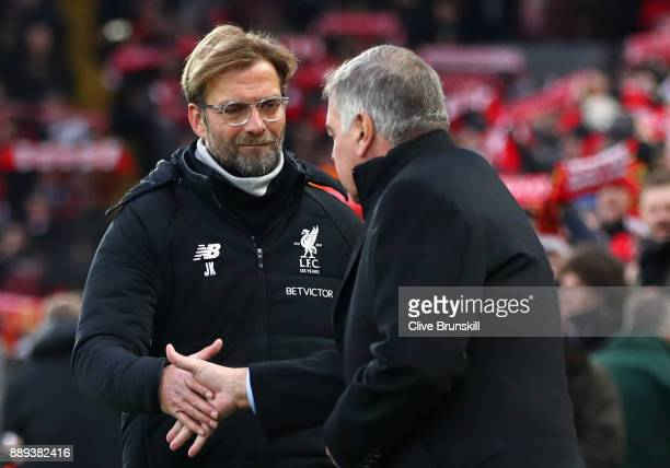 Jurgen Klopp Manager of Liverpool shakes hands with Sam Allardyce Manager of Everton during the Premier League match between Liverpool and Everton at...