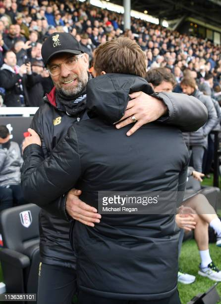 Jurgen Klopp Manager of Liverpool shakes hands with Scott Parker Caretaker Manager of Fulham ahead of the Premier League match between Fulham FC and...