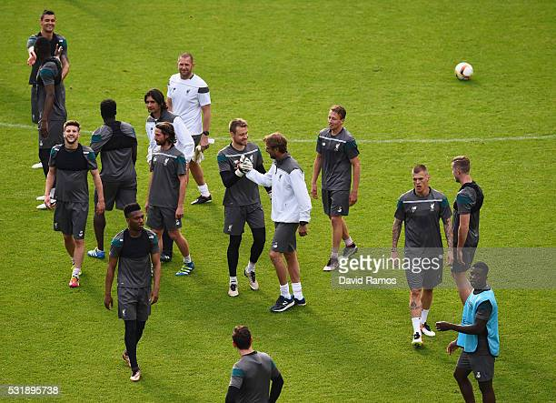 Jurgen Klopp manager of Liverpool shakes hands with Simon Mignolet during a Liverpool training session on the eve of the UEFA Europa League Final...