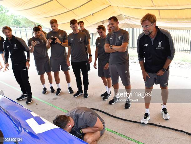 Jurgen Klopp manager of Liverpool shouting encouragement as players change tyres during a tour of Roush Fenway Racing on July 21 2018 in Charlotte...