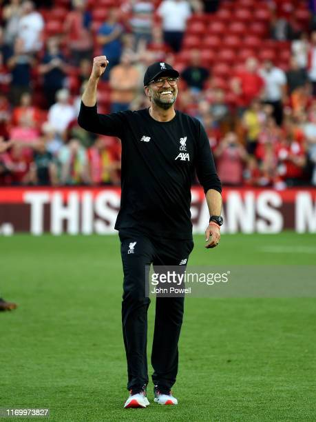 Jurgen Klopp manager of Liverpool showing his appreciation to the fans at the end of the Premier League match between Liverpool FC and Arsenal FC at...