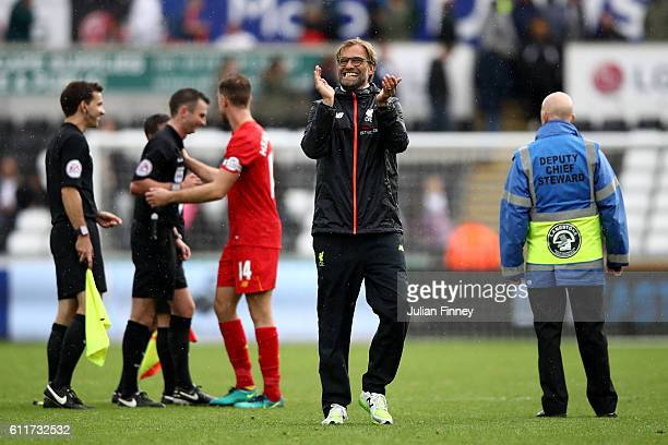 Jurgen Klopp Manager of Liverpool shows apperciation to the fans after his sides win during the Premier League match between Swansea City and...