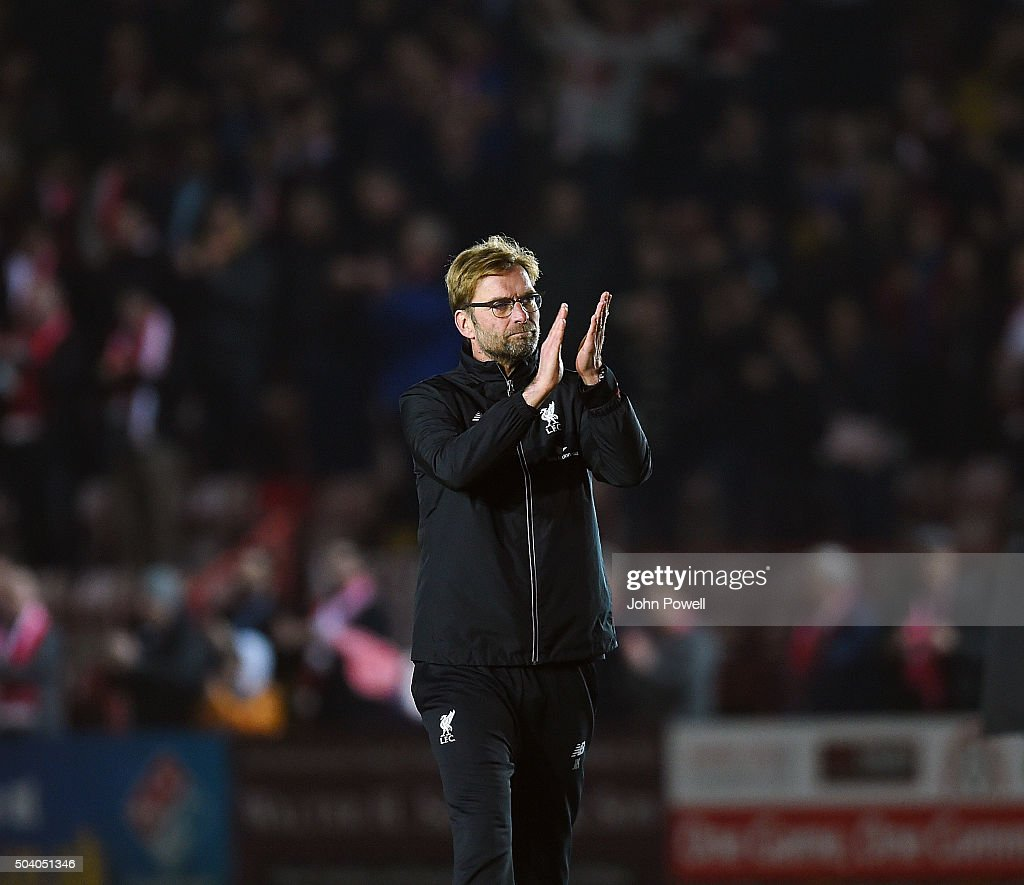 Jurgen Klopp manager of Liverpool shows his appreciation to the fans at the end of the Emirates FA Cup third round match between Exeter City and Liverpool at St James Park on January 8, 2016 in Exeter, England.