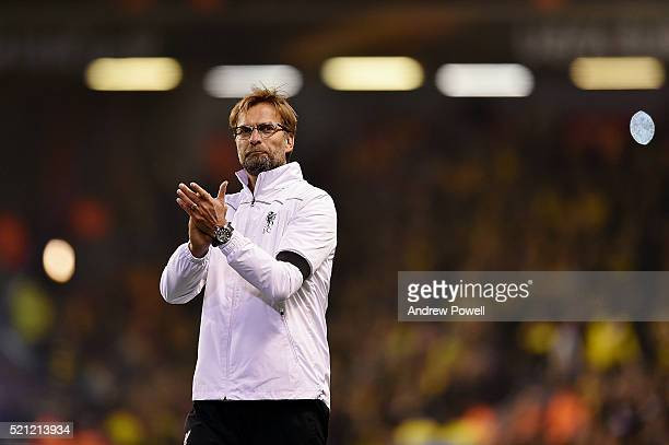 Jurgen Klopp manager of Liverpool shows his appreciation to the fans at the end of during the UEFA Europa League Quarter Final Second Leg match...