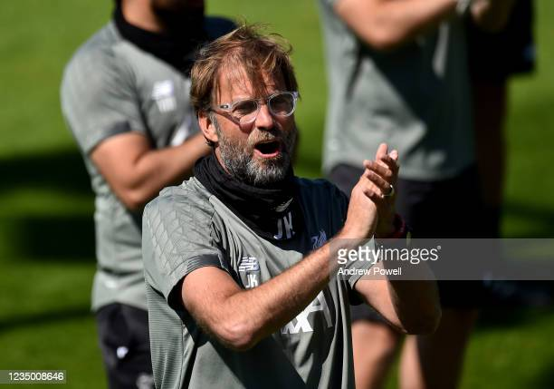 Jurgen Klopp manager of Liverpool singing Happy Birthday to former Liverpool players Steven Gerrard during a training session at Melwood Training...