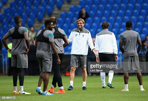 Jurgen Klopp manager of Liverpool smiles during a Liverpool training session on the eve of the UEFA Europa League Final against Sevilla at St...