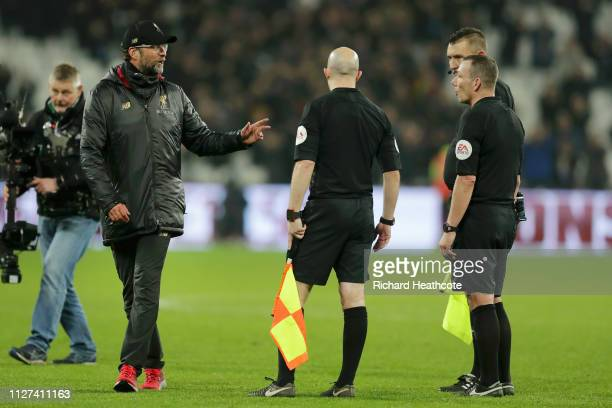 Jurgen Klopp, Manager of Liverpool speaks to referee Kevin Friend and assistant referees Matthew Wilkes and Simon Beck following the the Premier...
