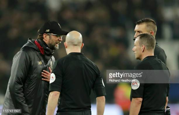 Jurgen Klopp Manager of Liverpool speaks to referee Kevin Friend and assistant referees Matthew Wilkes and Simon Beck following the the Premier...