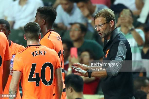 Jurgen Klopp Manager of Liverpool speaks to Ryan Kent during the Premier League Asia Trophy match between Liverpool and Crystal Palace at Hong Kong...