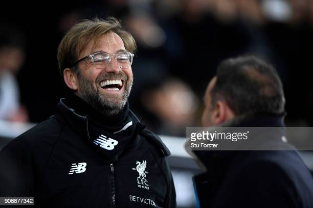 Jurgen Klopp Manager of Liverpool speaks with Carlos Carvalhal Manager of Swansea City prior to the Premier League match between Swansea City and...