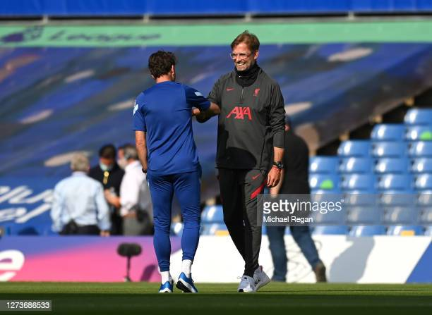 Jurgen Klopp Manager of Liverpool speaks with Chris Jones Chelsea Assistant Coach prior to the Premier League match between Chelsea and Liverpool at...