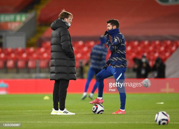Jurgen Klopp, Manager of Liverpool speaks with Christian Pulisic of Chelsea during the warm up prior to the Premier League match between Liverpool...