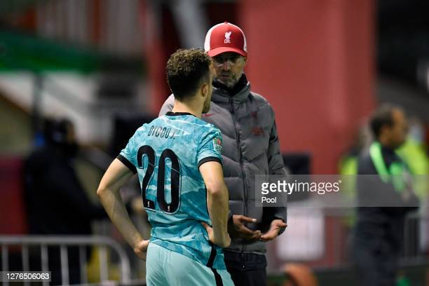 Jurgen Klopp Manager of Liverpool speaks with Diogo Jota of Liverpool during the Carabao Cup third round match between Lincoln City and Liverpool at...