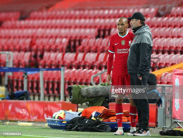 Jurgen Klopp, Manager of Liverpool speaks with Fabinho of Liverpool during the UEFA Champions League Group D stage match between Liverpool FC and FC...