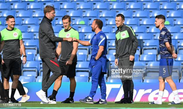 Jurgen Klopp Manager of Liverpool speaks with Jody Morris Chelsea Assistant Head Coach prior to the Premier League match between Chelsea and...