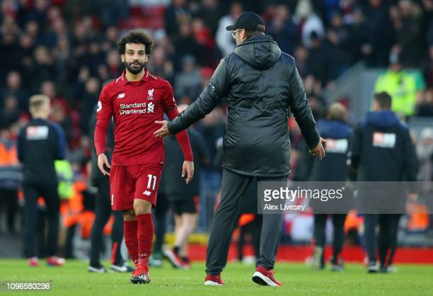 Jurgen Klopp Manager of Liverpool speaks with Mohamed Salah of Liverpool after the Premier League match between Liverpool FC and AFC Bournemouth at...