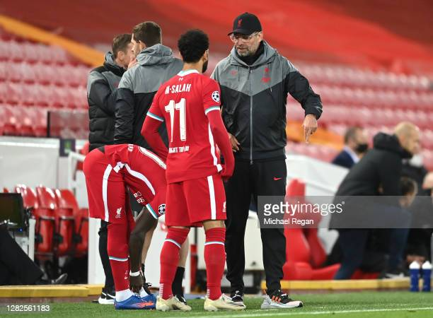 Jurgen Klopp Manager of Liverpool speaks with Mohamed Salah of Liverpool during the UEFA Champions League Group D stage match between Liverpool FC...