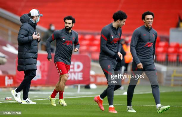 Jurgen Klopp , Manager of Liverpool speaks with Mohamed Salah of Liverpool during the warm up prior to the Premier League match between Liverpool and...