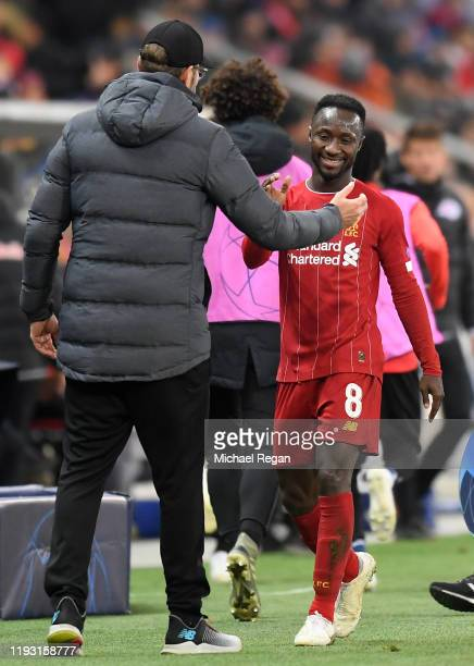 Jurgen Klopp Manager of Liverpool speaks with Naby Keita of Liverpool during the UEFA Champions League group E match between RB Salzburg and...