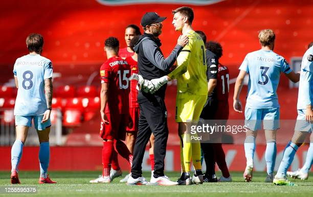 Jurgen Klopp Manager of Liverpool speaks with Nick Pope of Burnley following the Premier League match between Liverpool FC and Burnley FC at Anfield...