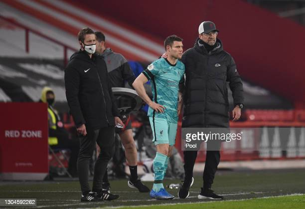 Jurgen Klopp, Manager of Liverpool speaks with Substitute, James Milner of Liverpool before entering the pitch during the Premier League match...