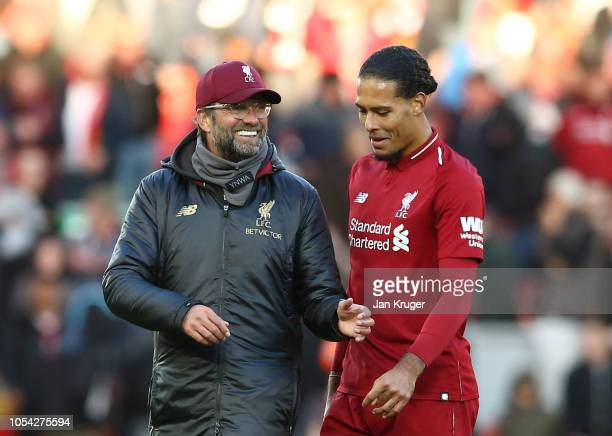 Jurgen Klopp Manager of Liverpool speaks with Virgil van Dijk of Liverpool after the Premier League match between Liverpool FC and Cardiff City at...