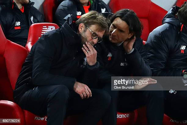 Jurgen Klopp Manager of Liverpool speaks with Zeljko Buvac assistant manager during the Premier League match between Liverpool and Manchester City at...