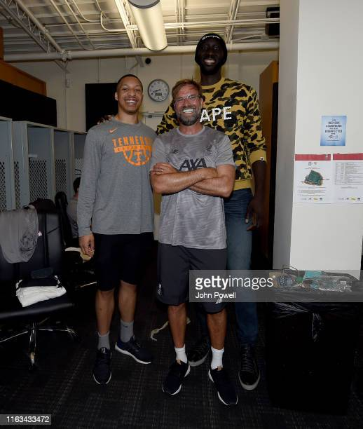 Jurgen Klopp manager of Liverpool Tacko Fall Senegalese basketball player and Grant Williams after the PreSeason Friendly match between Sevilla and...