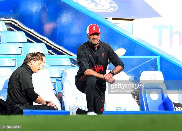 Jurgen Klopp manager of Liverpool taking a knee for Black Lives Matter during the Premier League match between Chelsea and Liverpool at Stamford...