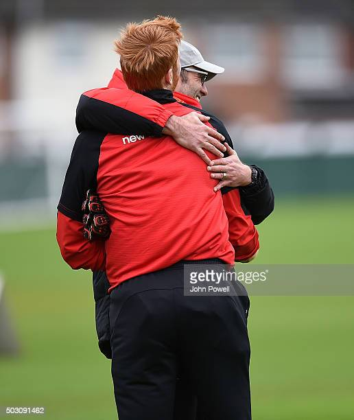 Jurgen Klopp manager of Liverpool talking with Adam Bogdan of Liverpool during a training session at Melwood Training Ground on January 1 2016 in...