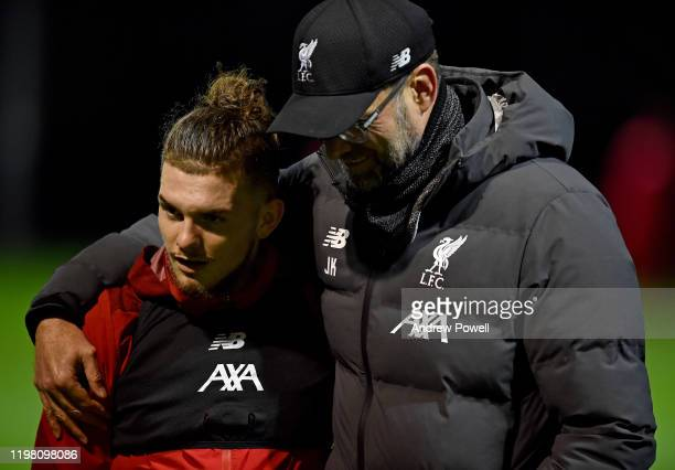 Jurgen Klopp manager of Liverpool talking with Harvey Elliott during a training session at Melwood Training Ground on January 07 2020 in Liverpool...