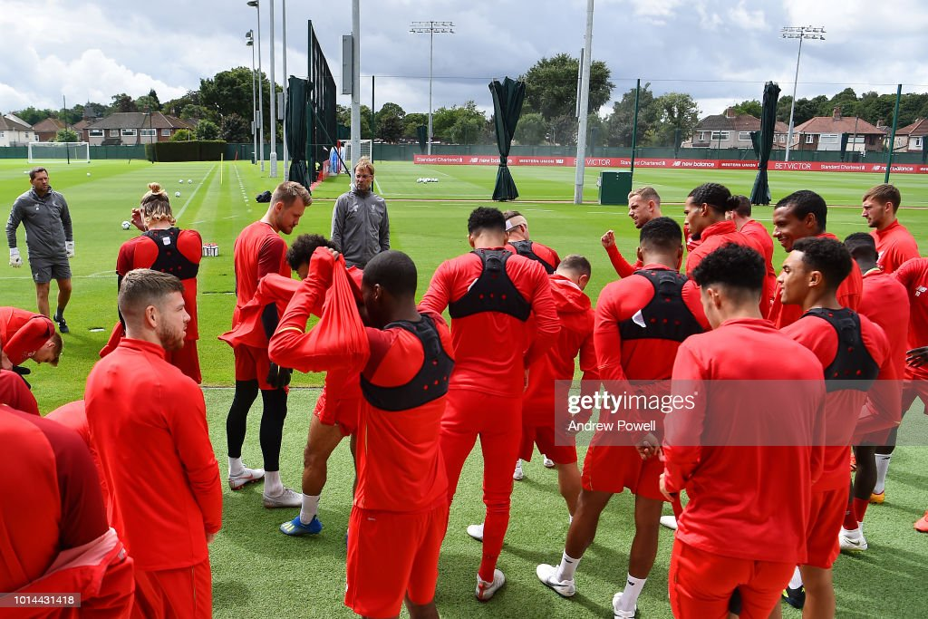 Jurgen Klopp manager of Liverpool talking with his players during a training session at Melwood Training Ground on August 10, 2018 in Liverpool, England.