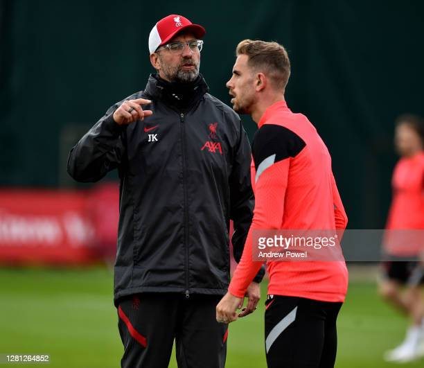 Jurgen Klopp manager of Liverpool talking with Jordan Henderson captain of Liverpool during a training session ahead of the UEFA Champions League...