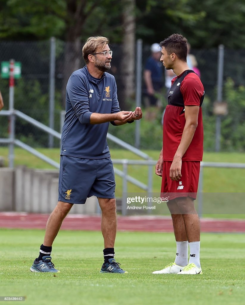 Jurgen Klopp manager of Liverpool talking with Marko Grujic during a training session at Rottach-Egern on July 27, 2017 in Munich, Germany.