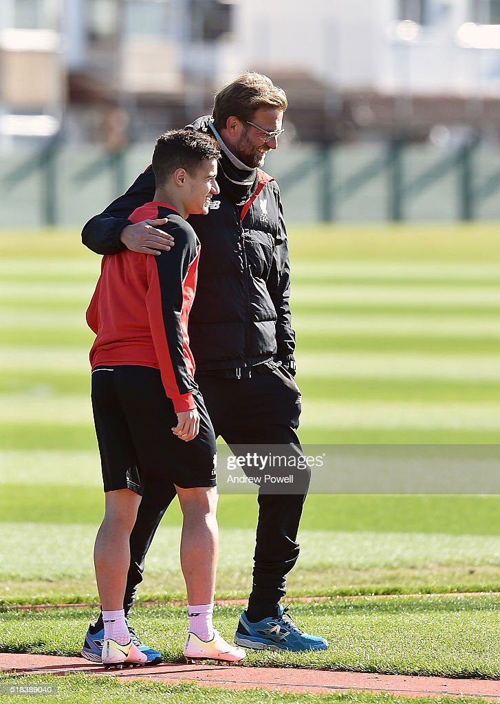 Jurgen Klopp manager of Liverpool talking with Philippe Coutinho of Liverpool during a training session at Melwood Training Ground on March 31, 2016 in Liverpool, England.