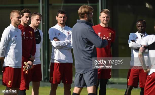 Jurgen Klopp manager of Liverpool talking with Ragnar Klavan Danny Ward Jordan Henderson Dejan Lovren Simon Mignolet and Sadio Mane during a training...
