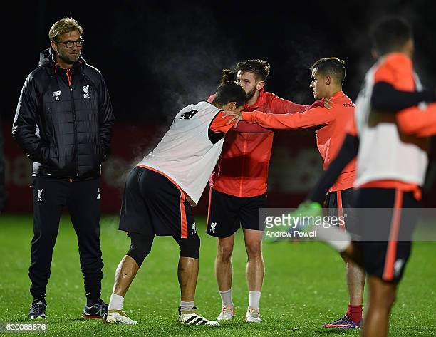 Jurgen Klopp manager of Liverpool talking with Roberto Firmino Philippe Coutinho and Adam Lallana during a training session at Melwood Training...
