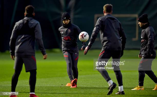 Jurgen Klopp manager of Liverpool talking with Takumi Minamino of Liverpool during a training session at Melwood Training Ground on October 29 2020...