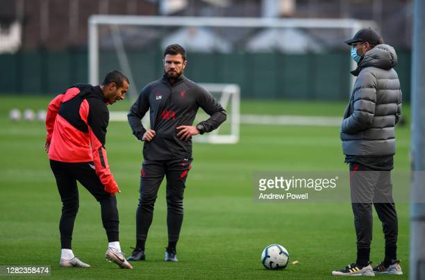 Jurgen Klopp manager of Liverpool talking with Thiago Alcantara of Liverpool during the training session at Melwood Training Ground on October 26...