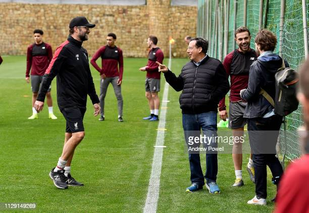 Jurgen Klopp manager of Liverpool talking with Tom Werner part owner of Liverpool Football Club during a training session on February 12 2019 in...